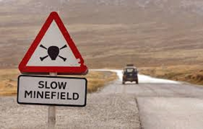 Slow Minefield sign