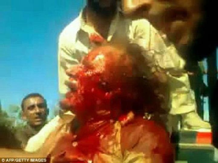 bleeding-gaddafi-twin-or-cousin